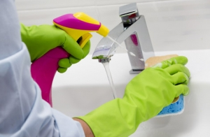 Sink being cleaned with sponge by Pure Cleaning services