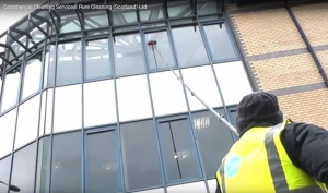 cleaning office windows with deionized water and water fed pole.